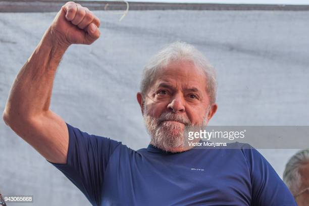 """SAO BERNARDO DO CAMPO, BRAZIL - APRIL 07:  Former President Luiz Inacio Lula da Silva gestures to supporters at the headquarters of the Metalworkers' Union where a Catholic mass was held in memory of his late wife Marisa Leticia on April 7, 2018 in the Sao Bernardo do Campo section of Sao Paulo, Brazil. An arrest warrant was issued on Thursday for da Silva to serve a 12-year jail term for corruption. The 72 year old former president told the crowd """"I will comply with their warrant."""" (Photo by Victor Moriyama/Getty Images)"""